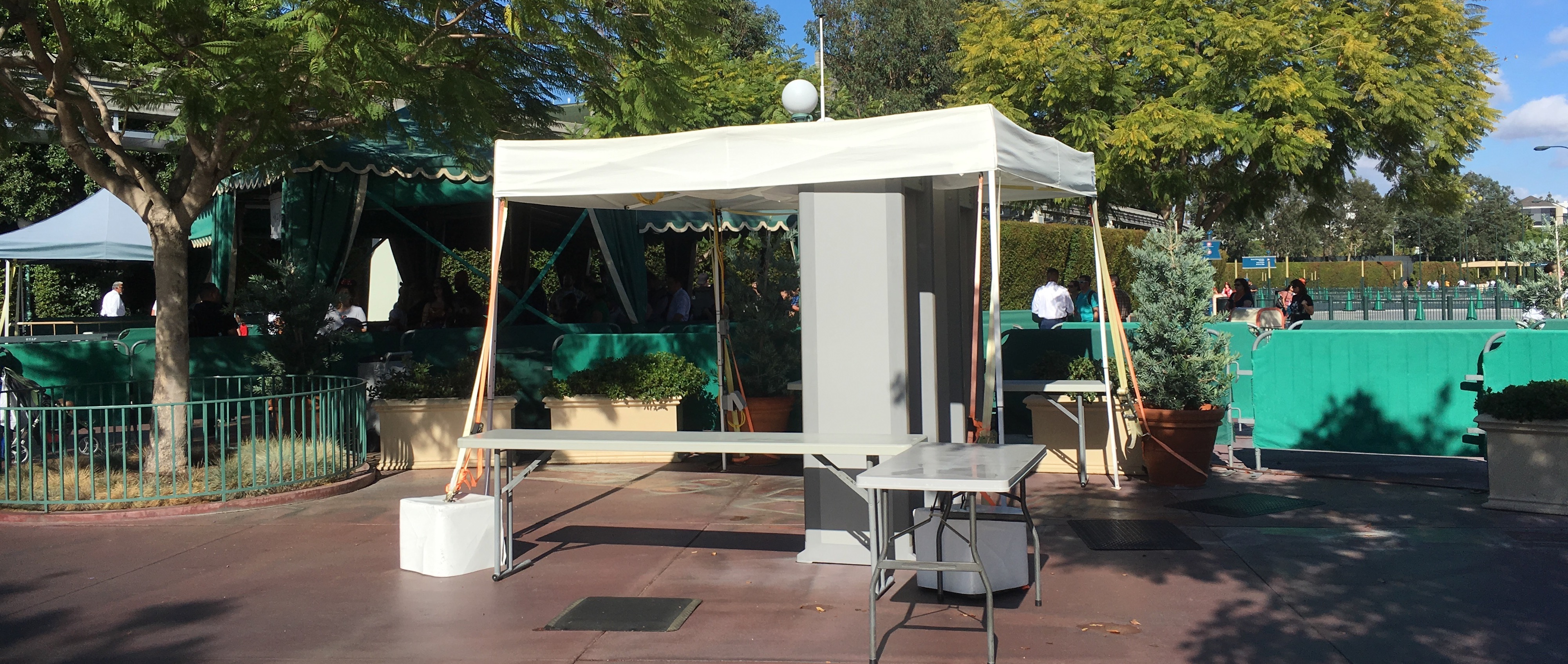 white pop up canopy with ripped top and pole sticking out